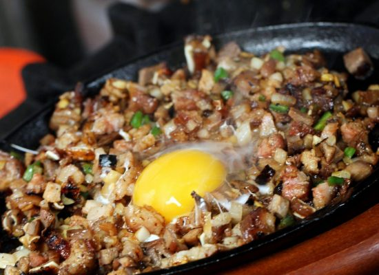 Bourdain: Ive got to have lechon and sisig in my New York market